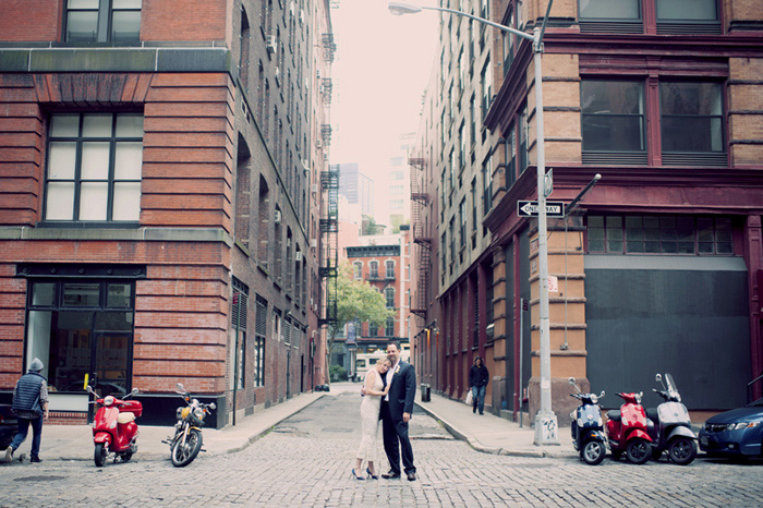 bride and groom kissing in New York street