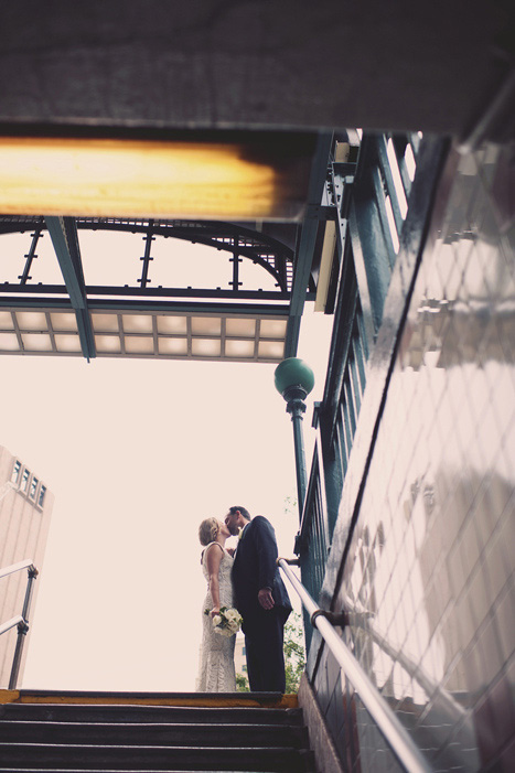 bride and groom outside subway entrance