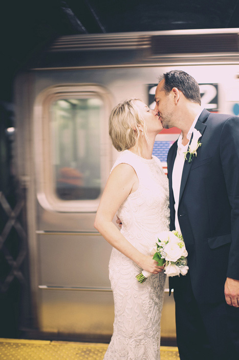 bride and groom in front in subway