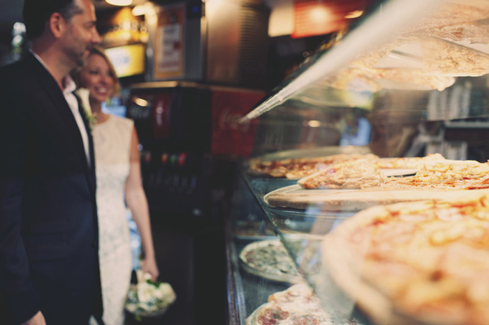 bride and groom in NYC pizzeria