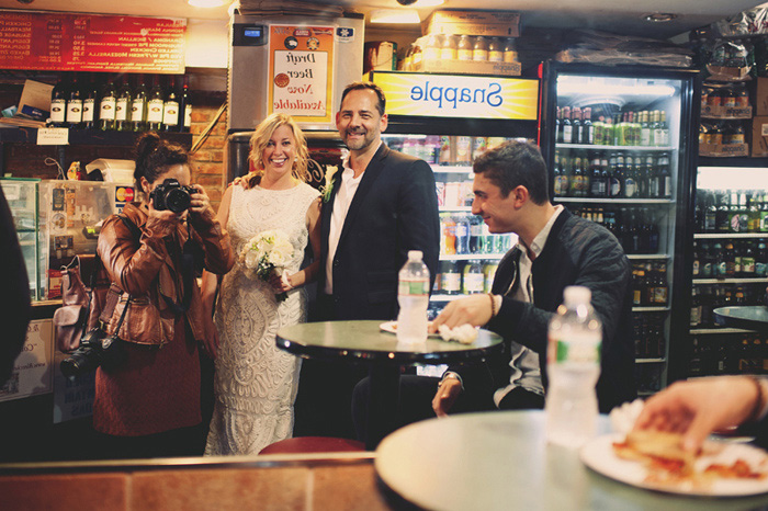 bride and groom in New York pizzeria
