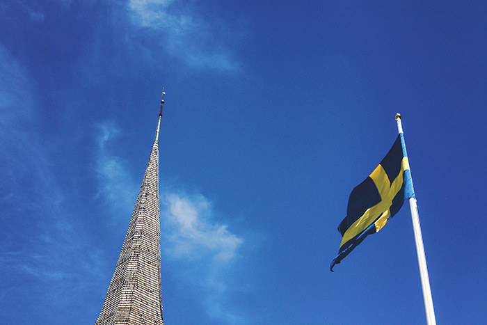 church steeple and swedish flag