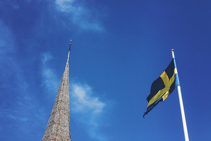 church steeple and swedish flag