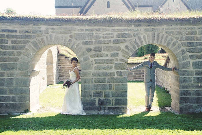 bride and groom portrait under archway