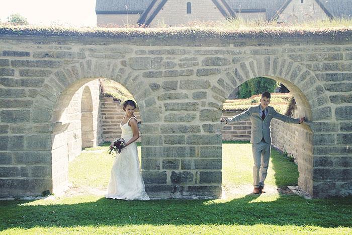 bride and groom portrait under archway