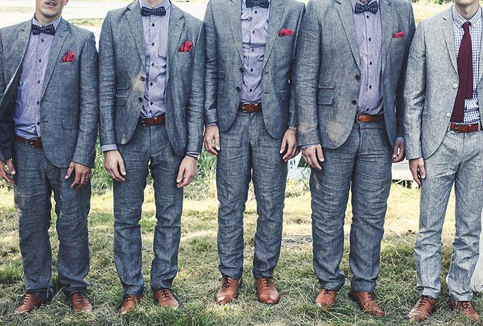 groomsmen in grey suits