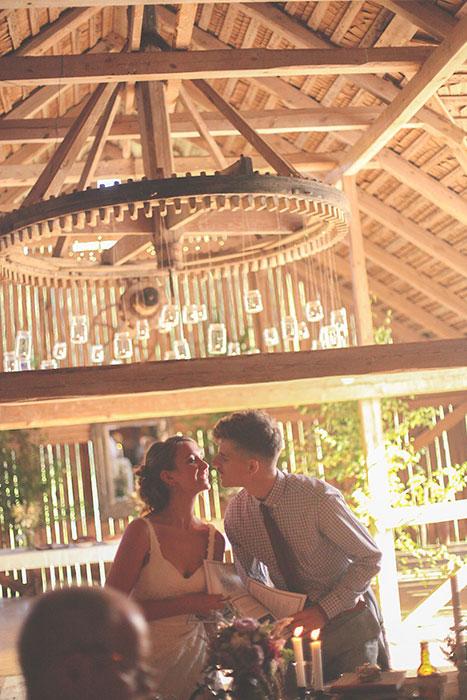 bride and groom at barn wedding reception