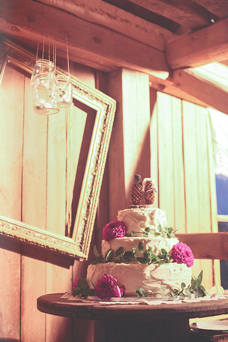 tiered white wedding cake with pink flowers