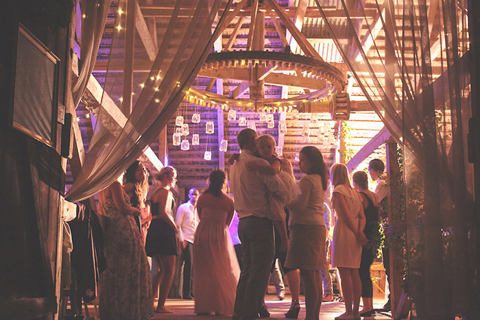 wedding guests dancing in barn