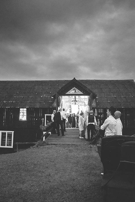 barn lit up for wedding reception