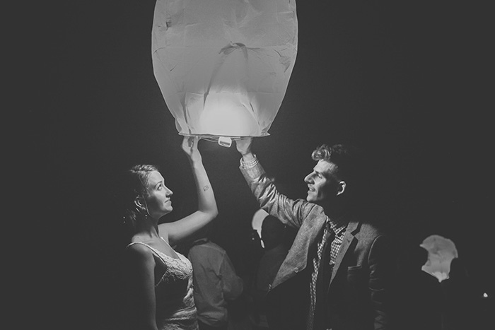 bride and groom releasing chinese wish lantern