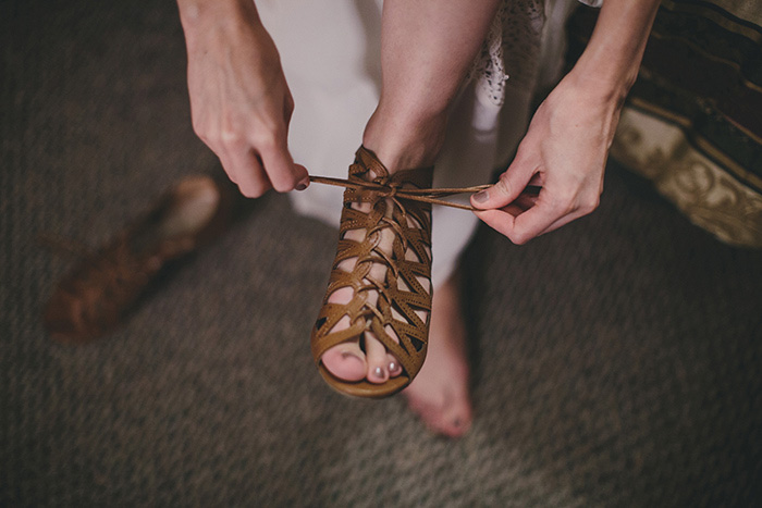bride tying her shoes