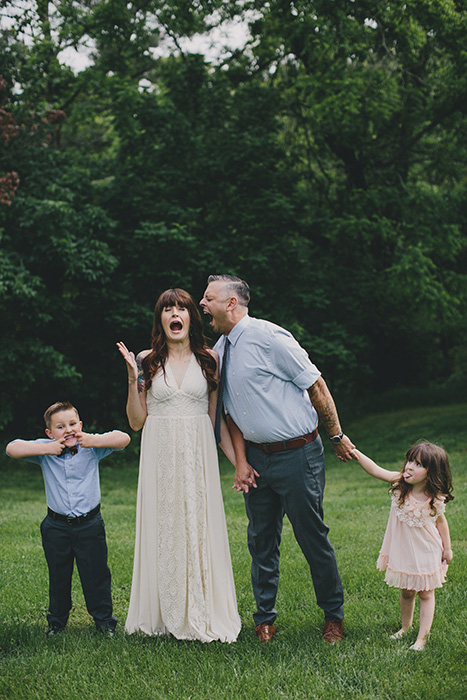 bride and groom being goofy with kids
