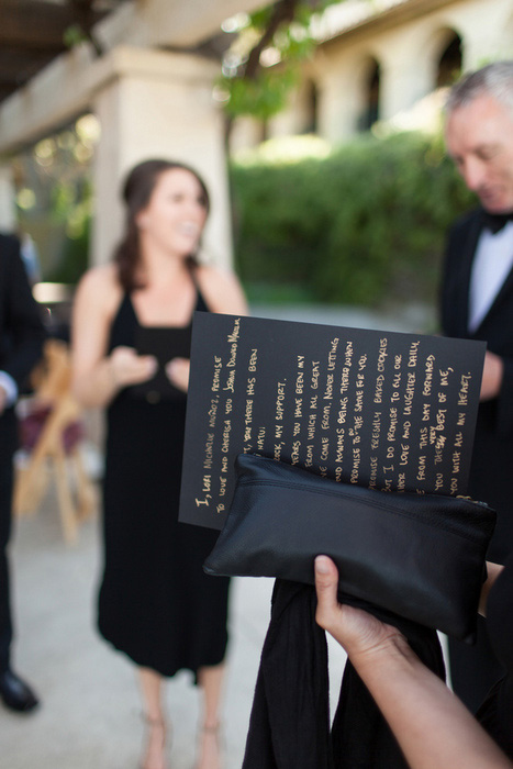 wedding vows written in gold on black