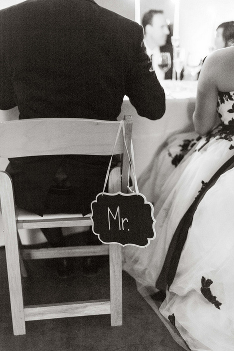 chalkboard Mr. wedding sign on back of chair