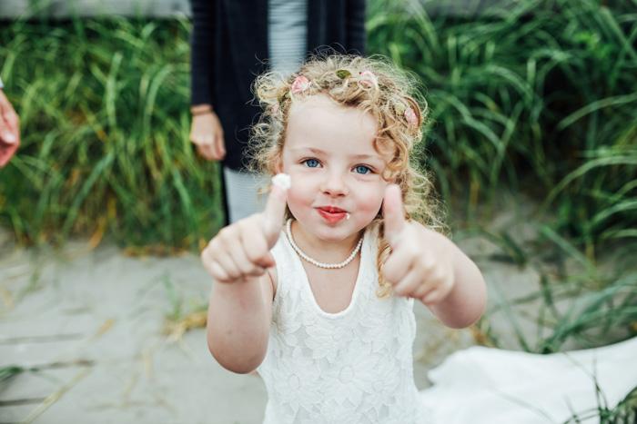 flower girl giving thumbs up