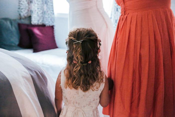 bride's daughter watching her mom