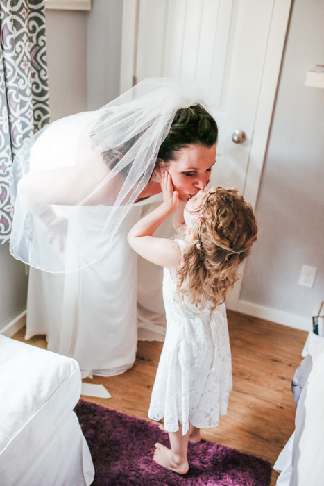 bride kissing her daughter