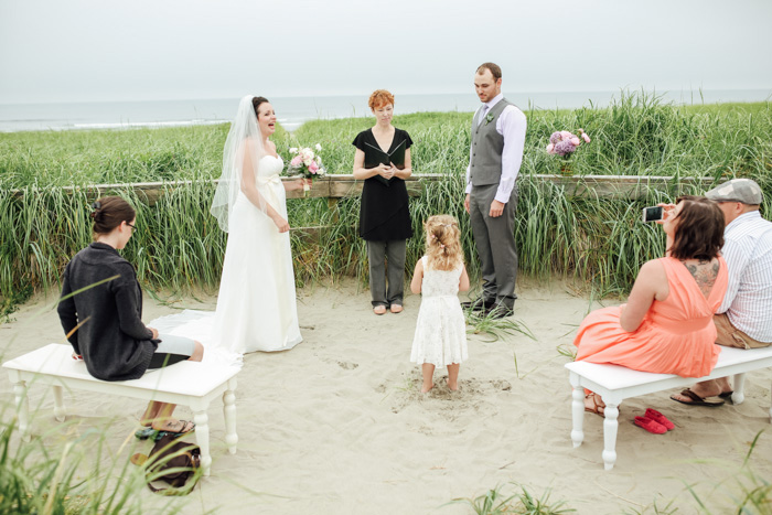 flower girl at beach ceremony