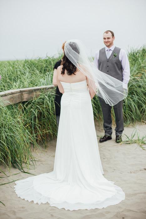 bride at beach altar