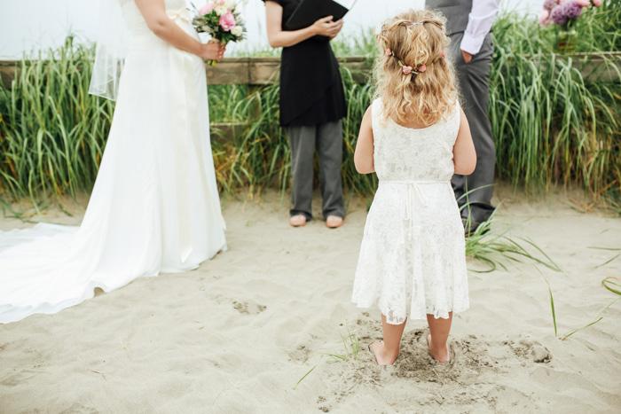 flower girl at beach ceremony