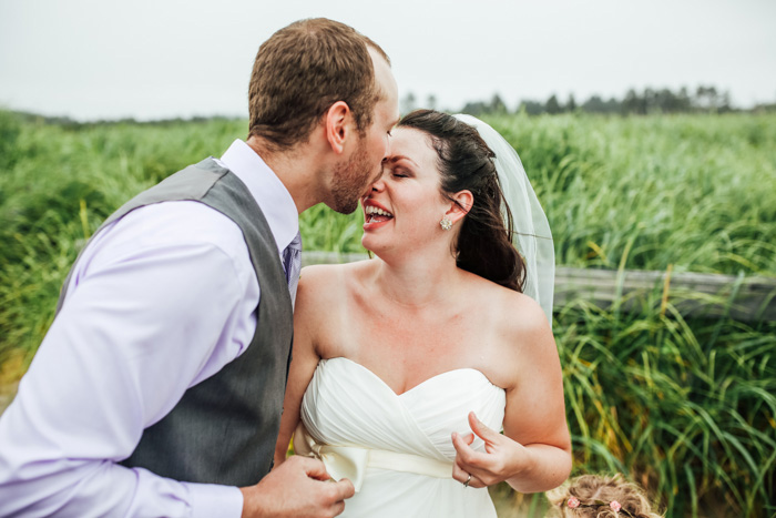 groom kissing bride on nose
