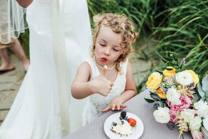 flower girl eating cake