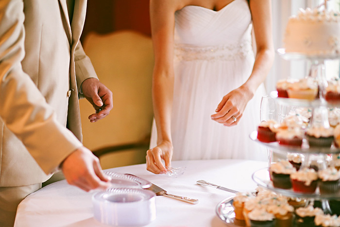 bride and groom getting ready to cut the cake