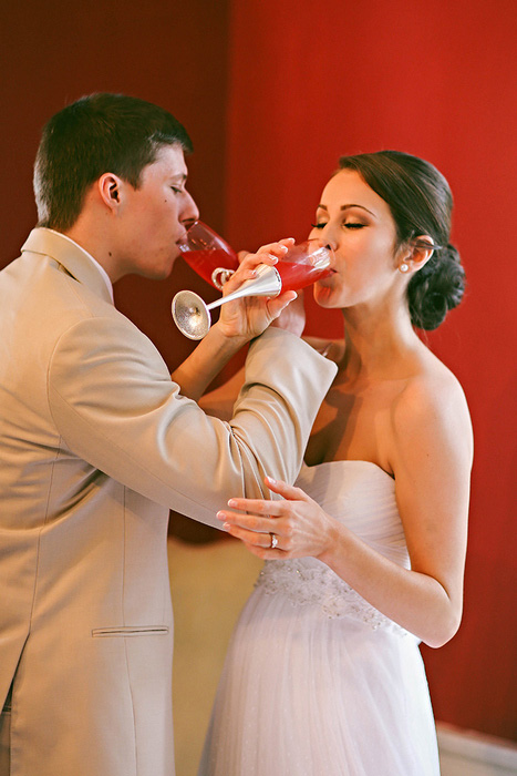 brid and groom drinking champagne