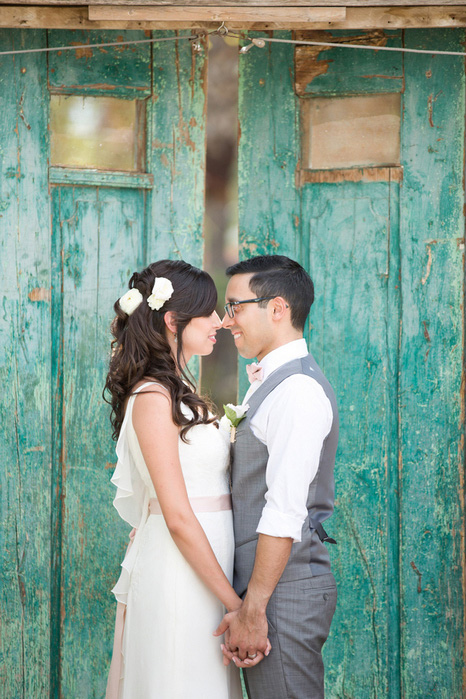 wedding portrait with bride and groom  facing each other
