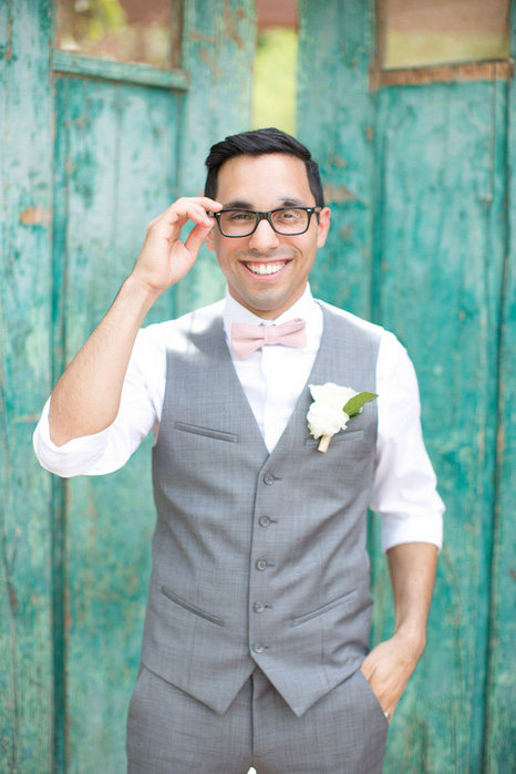 groom adjusting glasses