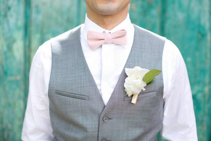 groom in grey vest and pink bow tie