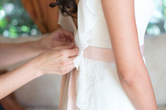 zipping bride's dress