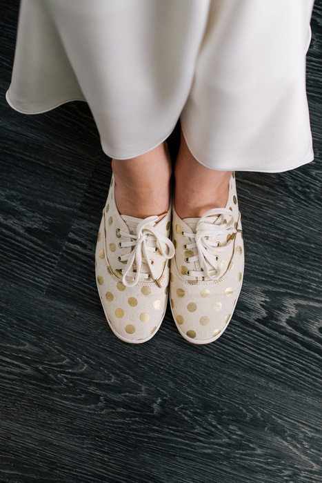 bride in gold polka dot sneakers