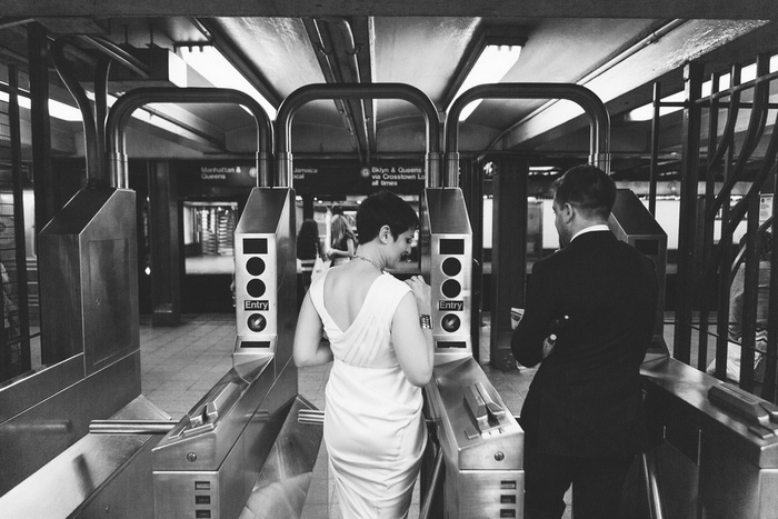 bride and groom entering subway