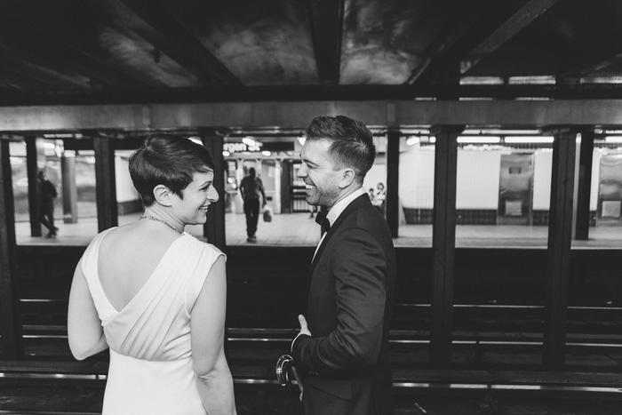 bride and groom on subway platform