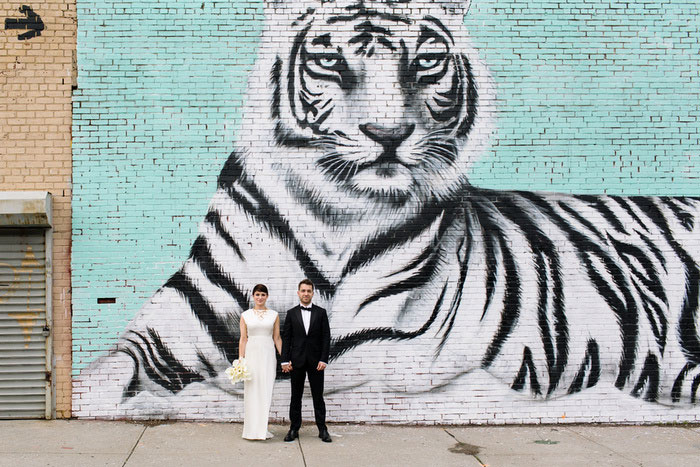wedding portrait in front of tiger mural