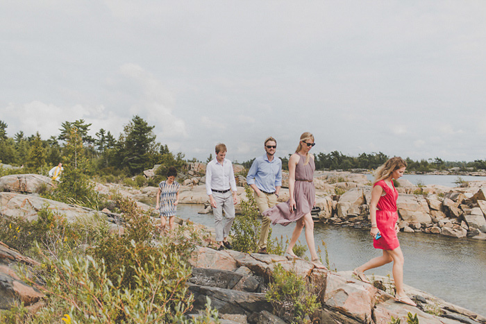 wedding guests walking on rocks