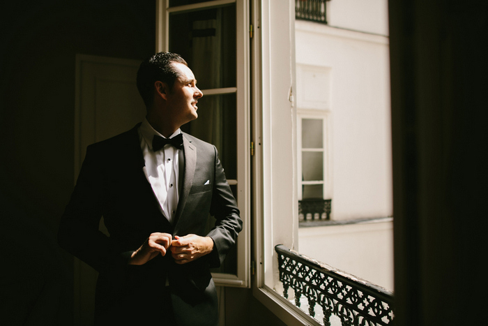 groom looking out Paris window