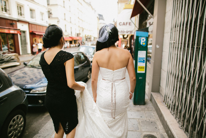 bride and maid of honor walking through Paris