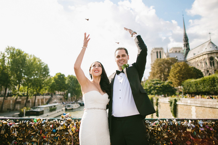 Bride and groom tossing lock keys in the seine