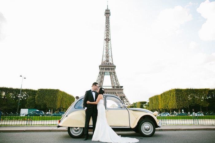 bride and groom in front of eiffel tower