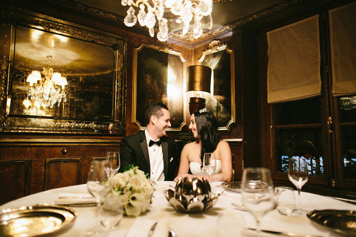 bride and groom in paris restaurant