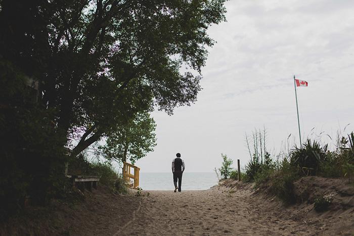 groom walking down to beach
