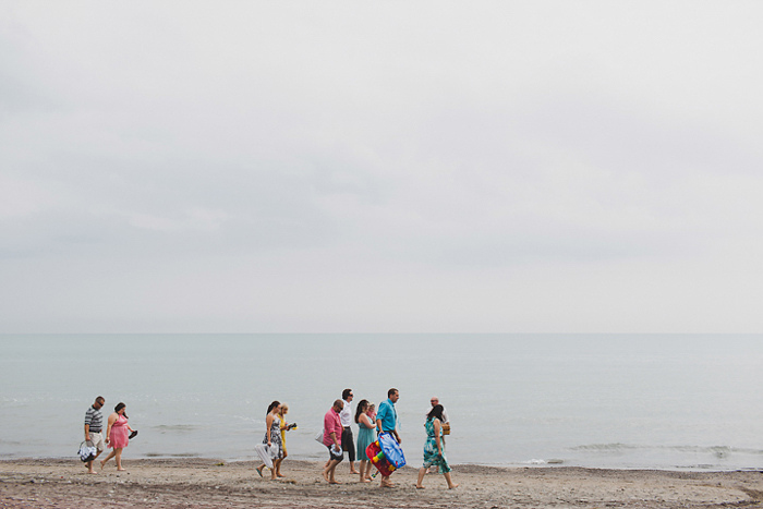 wedding guests walking on the beach