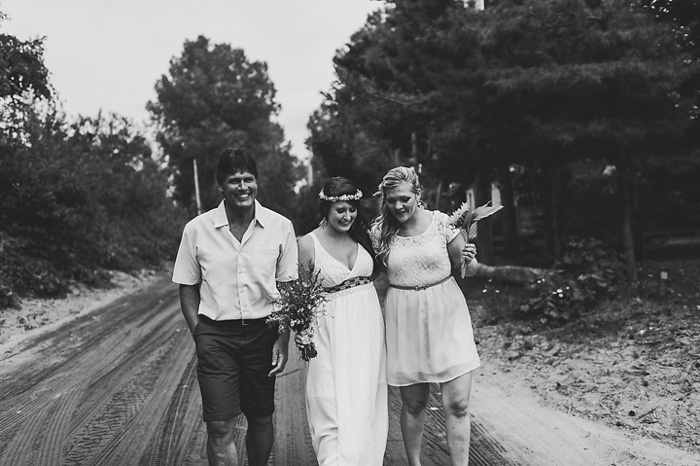 bride walking with her father and maid of honor