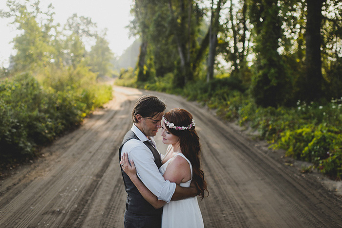 bride and groom on cottage road