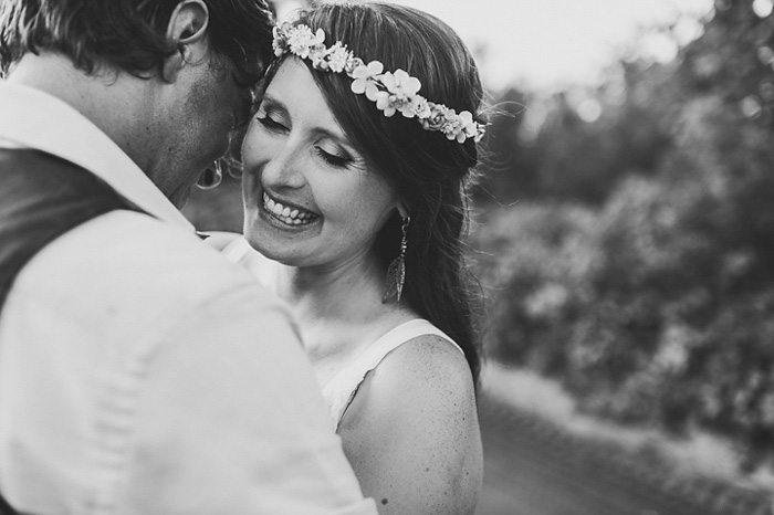 bride laughing while hugging groom