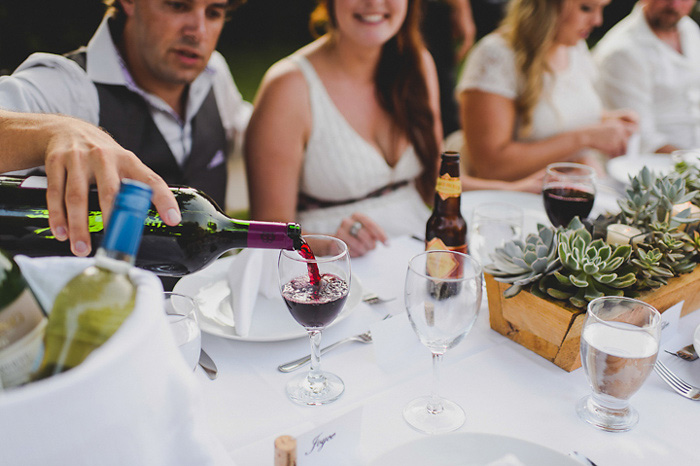 groom pouring wine
