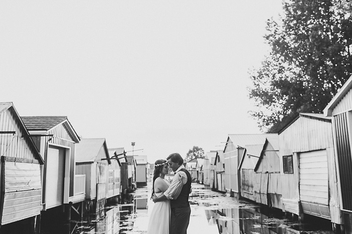 bride and groom portraits by boathouses